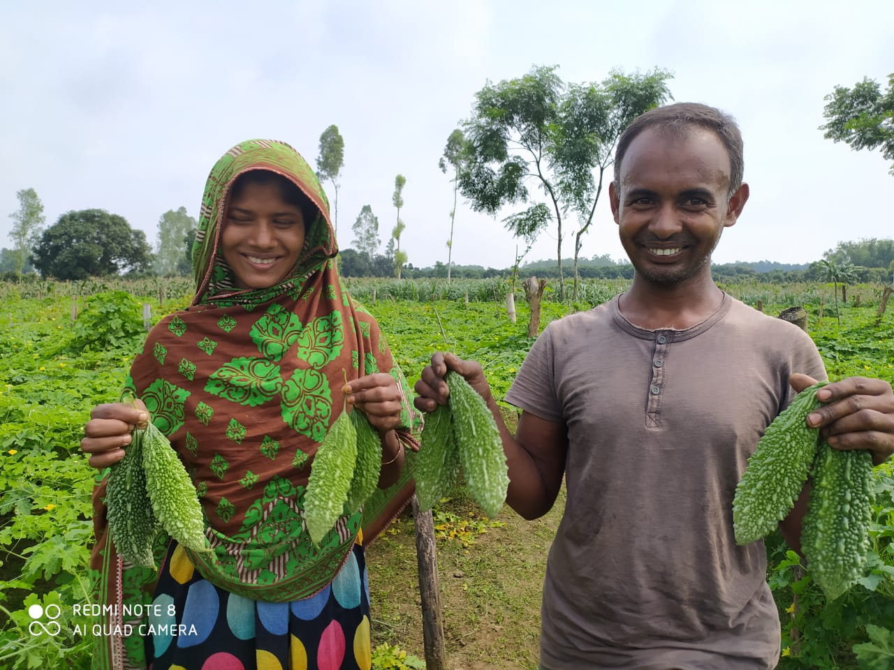 Happy farmers in Bangladesh with lalteer